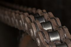 Motorcycle chain in detailed image. Photo of motorcycle chain in detailed image Royalty Free Stock Images