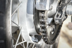 Motorcycle chain and rear sprocket. Dirty motorcycle chain and rear sprocket Royalty Free Stock Images