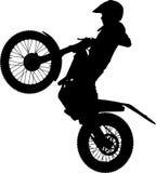 Motorcycle. Child rises motocross bike on the back wheel Royalty Free Stock Photography