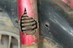Motorcycle chock absorber rusty crack. Broken Royalty Free Stock Image