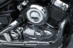 Motorcycle Chrome Engine. Detail of motorcycle engine with chrome covers Royalty Free Stock Image