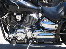 Motorcycle chromed engine closeup detail. Side view Royalty Free Stock Photography