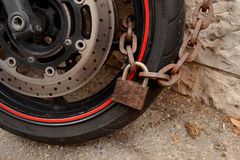 Motorcycle on a circuit. Bike chained with a lock per wheel Royalty Free Stock Image