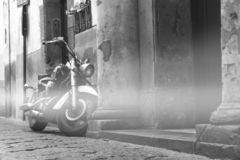 Motorcycle classic on the street, old mountain street, tour travel concept design, space for the text black and white royalty free stock image