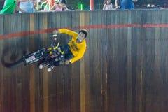 Motorcycle climb and run on the circle wall Royalty Free Stock Photography