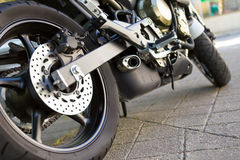 Motorcycle. Closeup of a modern motorcycle engine side view with rear disk brakes Stock Images