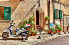 Motorcycle on cobbled street. Stock Image