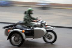 Motorcycle combination. Motorcyclist in the motorcycle combination rain; motion blur Royalty Free Stock Photo