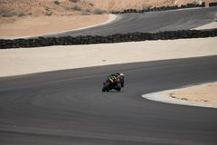 Motorcycle competition on a race track on. A training day b.b royalty free stock photos