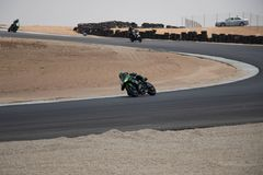 Motorcycle competition on a race track on. A training day b.b royalty free stock photography