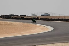 Motorcycle on a race track on a training day b.b. Motorcycle competition on a race track on a training day b.b royalty free stock photos