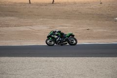 Motorcycle competition on a race track on. A training day b.b royalty free stock images