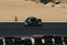Motorcycle competition on a race track on. A training day b.b royalty free stock image