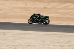 Motorcycle competition on a race track on. A training day b.b stock image