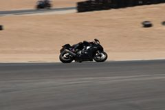 Motorcycle on a race track on a training day b.b. Motorcycle competition on a race track on a training day b.b stock image