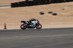Motorcycle on a race track on a training day b.b. Motorcycle competition on a race track on a training day b.b royalty free stock images