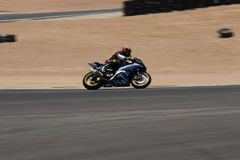 Motorcycle on a race track on a training day b.b. Motorcycle competition on a race track on a training day b.b stock photos