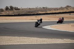 Motorcycles on a race track on a training day b.b. Motorcycle competition on a race track on a training day b.bn royalty free stock image