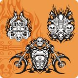 Motorcycle compositions. With use of a flame, engines, exhaust pipes and skulls Royalty Free Stock Photography