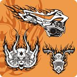 Motorcycle compositions - set 15. Motorcycle compositions with use of a flame, engines, exhaust pipes and skulls Royalty Free Stock Photography
