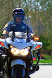 Motorcycle Cop. Police trained in roving traffic stops for the Trial Run of the 2011 Redlands Classic Royalty Free Stock Photography