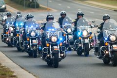 Motorcycle Cops Form Escort For Bikers At Charity Bike Ride Royalty Free Stock Photos