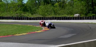 Motorcycle Cornering Race. Motorcyclists rounding the curve at race track days Royalty Free Stock Image