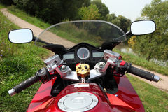Motorcycle on country road royalty free stock images