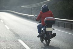 Motorcycle Courier On The Highway Royalty Free Stock Image