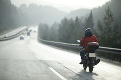 Motorcycle Courier On The Highway Royalty Free Stock Photos