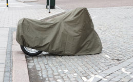 Motorcycle in a cover. Royalty Free Stock Images