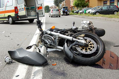 Motorcycle crash in urban area Royalty Free Stock Image