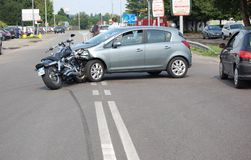 Motorcycle crash in urban area Stock Images