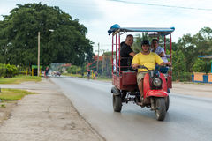 Motorcycle in Cuba transporting passengers Royalty Free Stock Photography