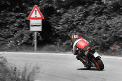 Motorcycle on the curve. Motorcycle on high speed make turn at the curve Stock Photos