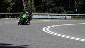 Motorcycle in a curve stock footage