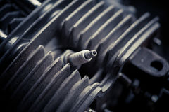 Motorcycle cylinder and spark plug detail Stock Photos