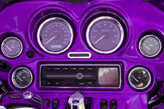 Motorcycle dashboard. Close-up view of bright purple motorcycle dashboard stock photography