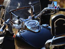 Motorcycle dashboard. A motorcycle dashboard with a chromed speedometer Stock Photography