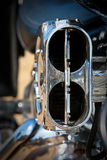 Motorcycle detail. Of air intake on engine in natural light Stock Photos