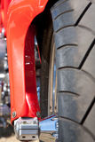 Motorcycle detail. Of tyre and red fork cover Stock Image