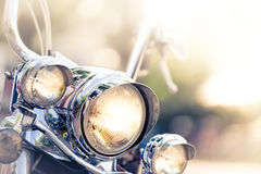 Motorcycle detail with headlamps in foreground Stock Image