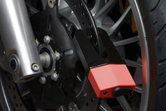 Motorcycle disc lock. A key lock to prevent someone stealing a motorcycle Stock Photo