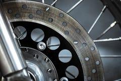 Motorcycle disk brake. Close-up shot of a motorcycle disk brake Stock Image