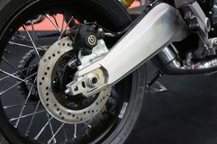 Motorcycle disk brakes are required to provide more grip to the tires and enable the riders to stop during an emergency. stock photo