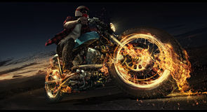 Motorcycle down the road. Man rides his motorcycle down the road. Flame and fire Royalty Free Stock Photos