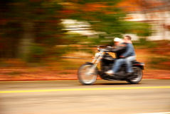 Motorcycle drive-by. A motorcycle with two riders zooming by Royalty Free Stock Photography