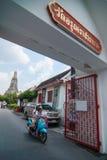 Motorcycle driver pass at Wat Arun gate Stock Photo