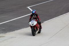 Motorcycle driver pulling to the paddocks Stock Images