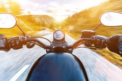Motorcycle driver riding in Alpine highway, handlebars view, Austria, Europe. Motorcycle driver riding in Alpine highway, handlebars view, Austria, central Royalty Free Stock Photography